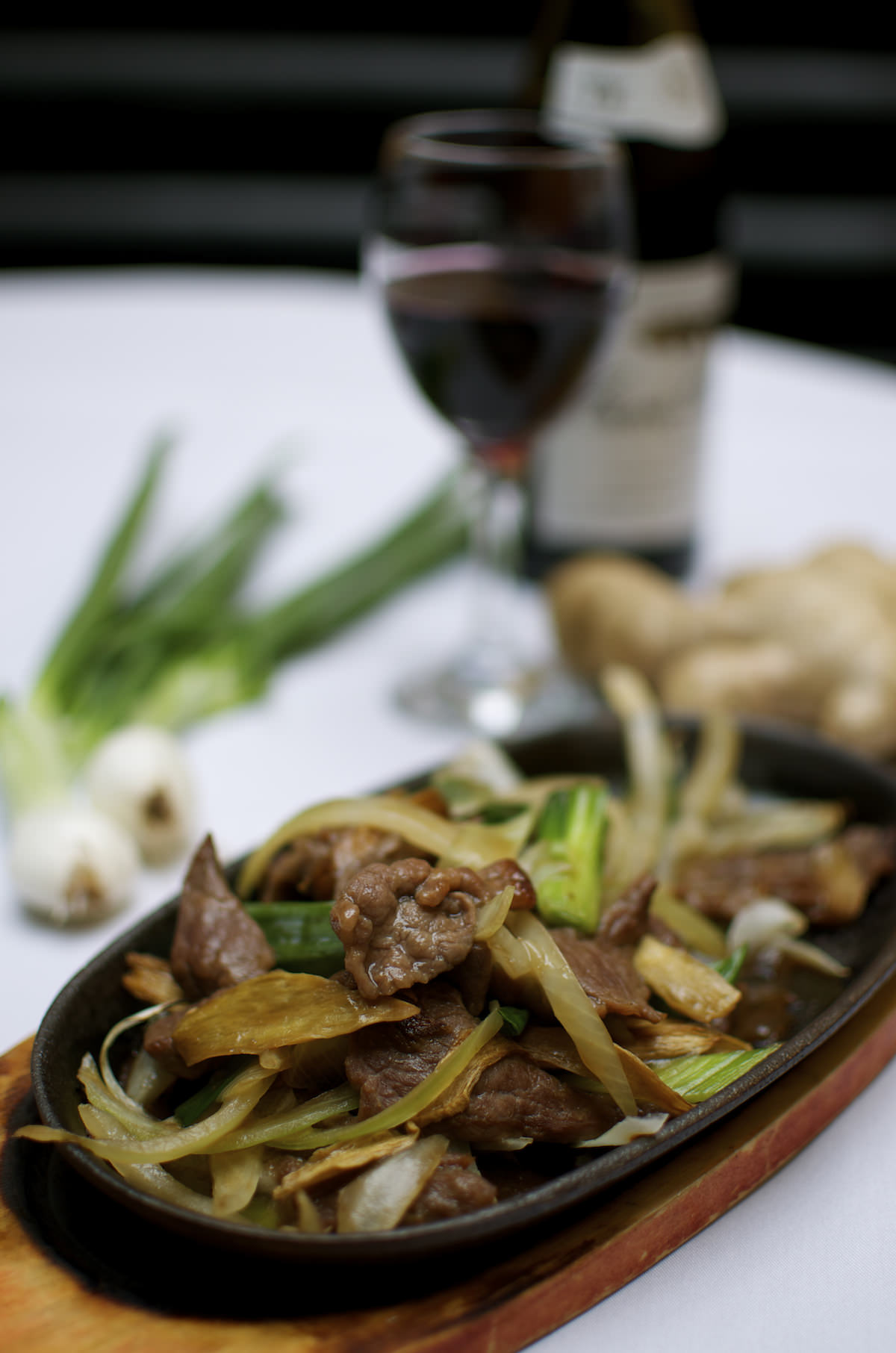 Naturally Chinese sizzling lamb with ginger and spring onions